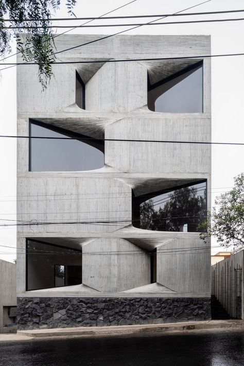 New York architecture studio Young  Ayata and Mexico City office Michan Architecture collaborated on DL1310, an apartment block with an exposed concrete facade.