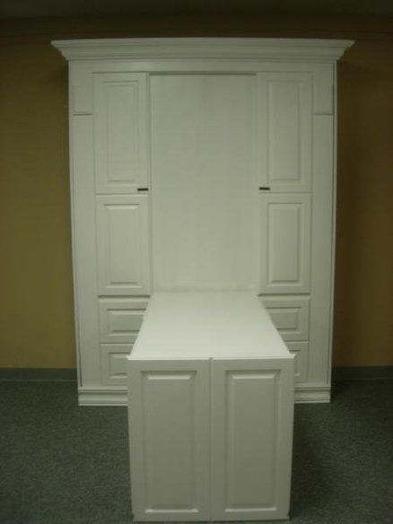 Attractive and easy table / murphy bed. Use cabinet fronts (think IKEA) and crown molding to enhance a murphy.