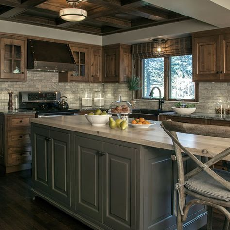 This custom kitchen brings rustic style to a new level of sophistication. Some of the beautiful features include knotty alder inset cabinets, custom grey painted island, hammered copper farm sink and custom hood.