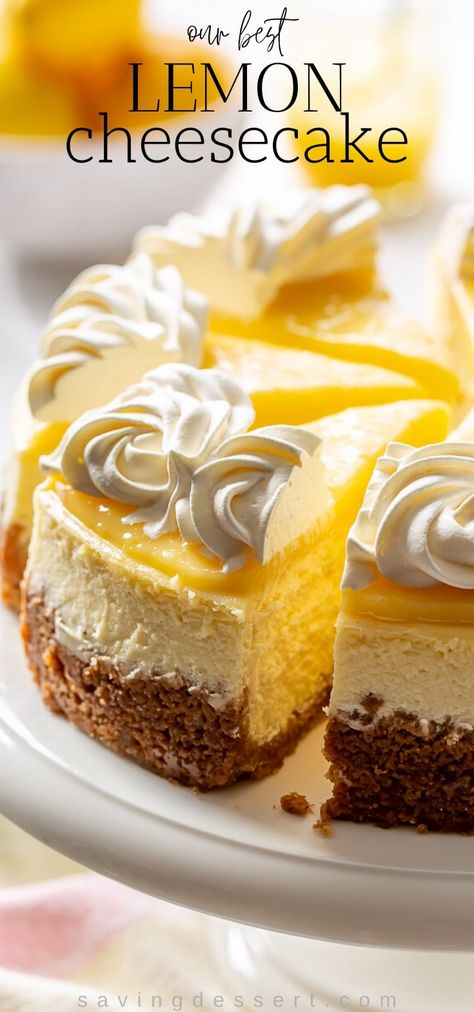 Bright and sunny New York-styled lemon cheesecake with a graham cracker crust, melt in your mouth filling and a zing from the tangy lemon curd topping. #lemoncurd #lemoncheesecake #lemoncheesecakerecipe #cheesecakerecipe #cheesecake #lemondessert