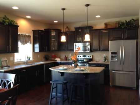The Kitchen In Our Orchard Glen Parade Home Features Beautiful Espresso  Cabinets And Granite Countertops.