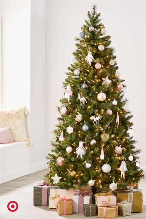Boasting a range of soft colors and intriguing finishes, this collection of ornaments embraces the magical feeling of the season while blending in classic designs for the perfect mix of traditional and modern.