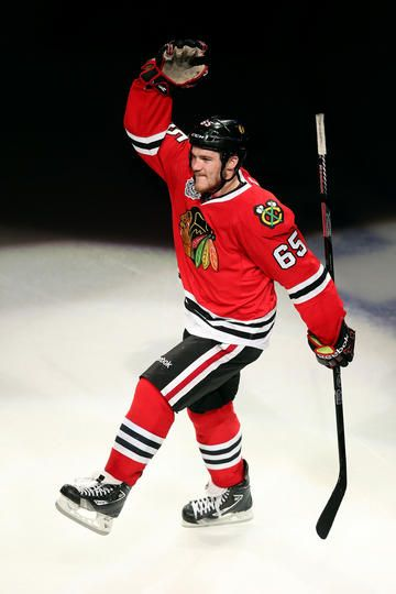 Andrew Shaw #65 of the Chicago Blackhawks celebrates after he was named a star of the game after they won 4-3 in the third overtime against the Boston Bruins in Game One of the 2013 NHL Stanley Cup Final at United Center on June 12, 2013 in Chicago, Illinois. (Photo by Jonathan Daniel/Getty Images)