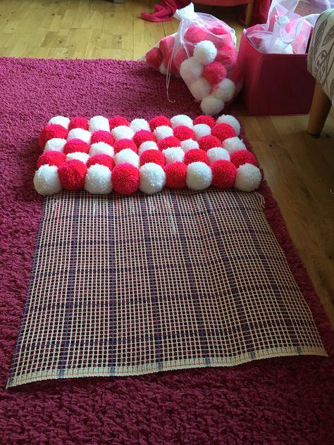 Pink and white Pom Pom rug in progress