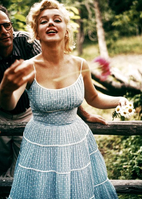 Marilyn looking fresh as a daisy, with her husband Arthur Miller,