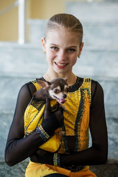 YEREVAN, ARMENIA - 11 OCTOBER: Alexandra Trusova of Russia poses with her  dog Tina during the ISU Junior G… | Figure skating, International skating  union, Alexandra