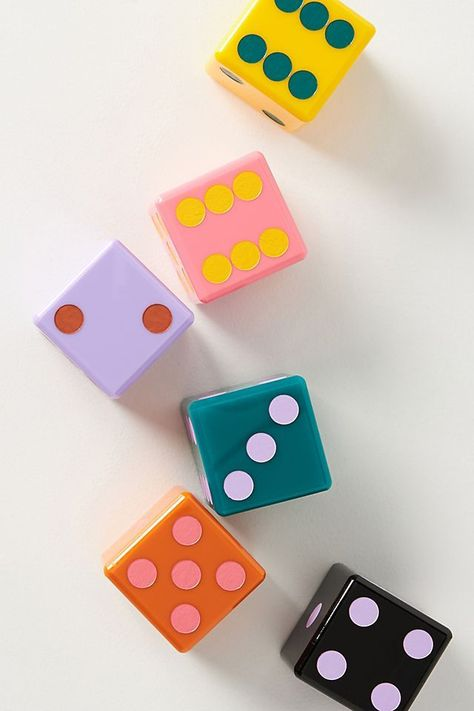 Take family game night to the next level with this set of oversized dice. Designed by Edie Parker in collaboration Anthropologie. each die features a handpainted blend of bright, complementary colors that is sure to surprise and delight.