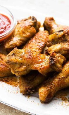 Looking for the best Chicken Wing recipes? Get recipes like Air Fryer Chicken Wings, Classic Baked Chicken and Old Bay Chicken Wings from Simply Recipes. Old Bay Chicken Wings Recipe, Chicken Wing Flavors, Roasted Chicken Wings, Honey Garlic Chicken Wings, Cooking Chicken Wings, Chicken Wing Recipes, Meat Recipes, Cooking Recipes, Honey Old Bay Wings Recipe