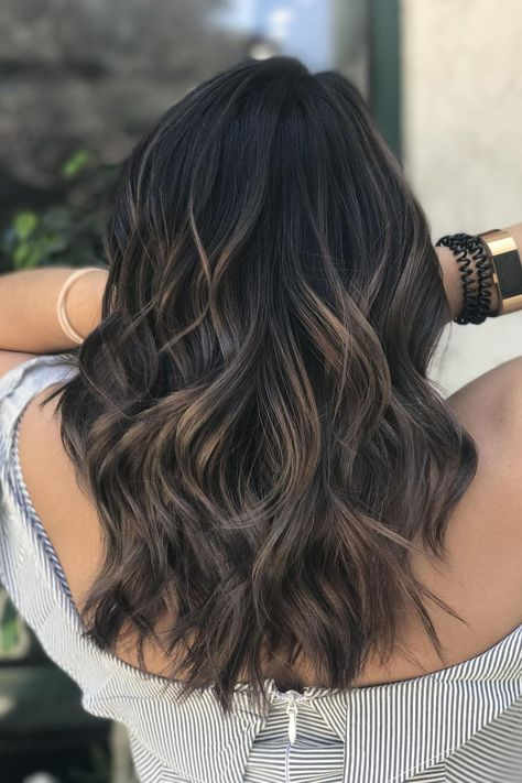 Dark Balayage | This ultra-dark cool brown gets some beige blonde and light ash brown balayage highlights for a more dimensional look that gives anedginess to the trendy wavy lob. #mushroom #brown #hair #trends #southernliving