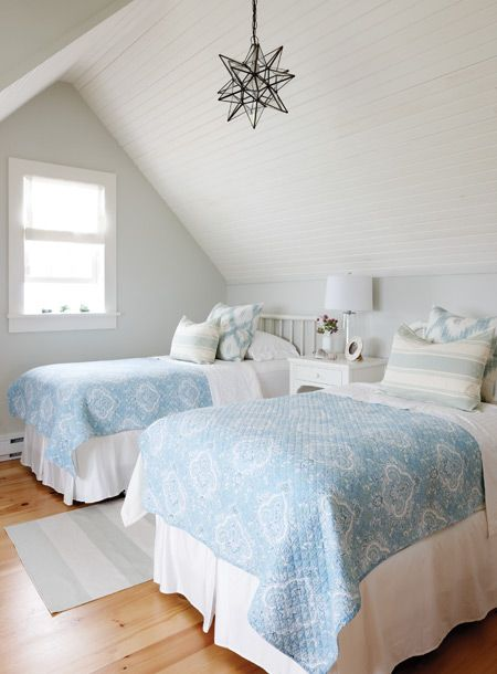 Blue and white is the perfect palette for a child's room or guest bedroom in this cottage style home