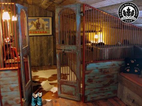 Children's bunkroom.  The metal door and sides look like an old cage from a bank.  This is just amazing and very kitschy!