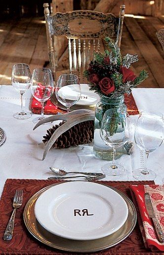 Double RL Ranch in Colorado: Vance Barn. A place setting includes Ralph Lauren Home placemats, napkins and flatware. The Double RL Ranch logo is on the plate.