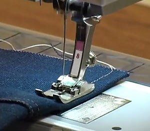 Use Jeans Foot #8 for sewing through heavy fabrics, multiple layers