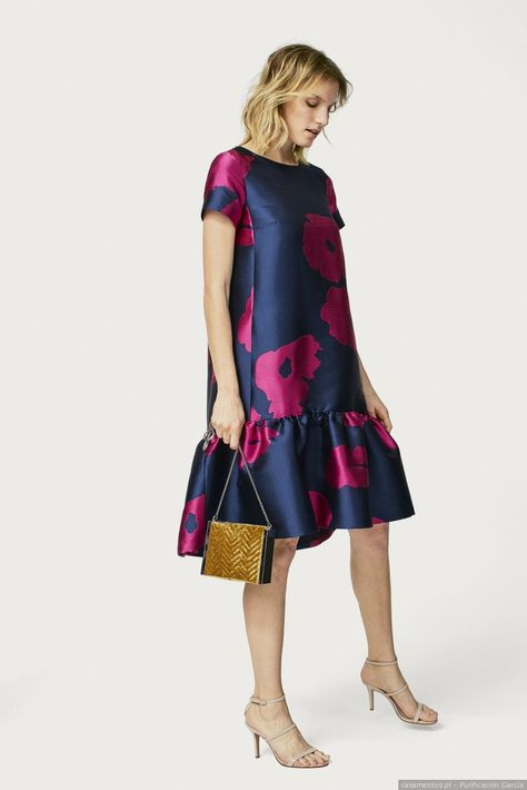Floral jacquard dress with ruffled hem.