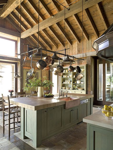 kitchen with green cabinets and hanging pots. Industrial Kitchen Island, Rustic Kitchen, New Kitchen, Kitchen Decor, Kitchen White, Industrial Pipe, Hanging Pots Kitchen, Sage Green Kitchen, Green Kitchen Island