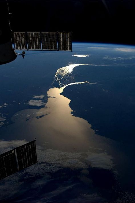 """Astronaut Karen Nyberg tweeted this photo from the International Space Station on July 19, 2013. Writing: """"Sunset over the Rio de la Plata in South America. July 15. pic.twitter.com/my3ViPDmB0"""""""
