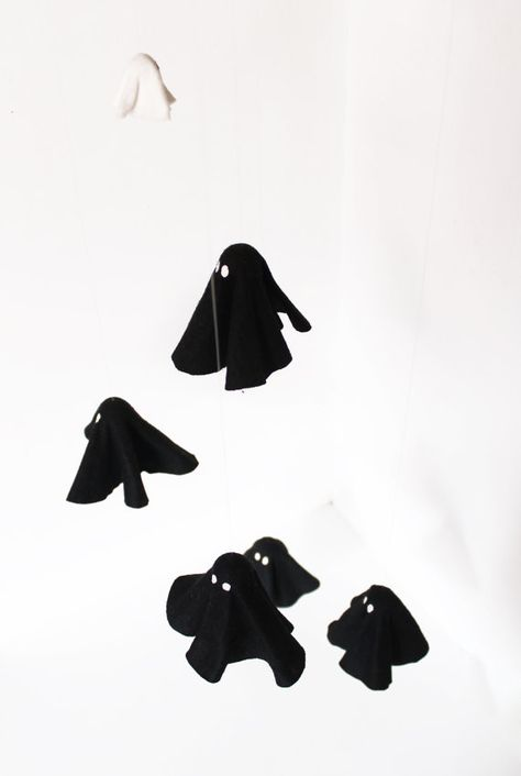 Mobile halloween decor. Black and white ghosts, and clouds mobile with stars.  Nice gift for any time and decoration for people of all ages.  Five black
