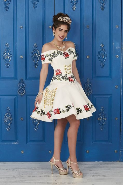 Make a bold statement in his gorgeous off the shoulder ball gown. The bodice is accented with corset boning, medal medallions, and beautifully decorated with multi-colored embroidery. LA Glitter Collection Dress 24035 Colors: Ivory Multi #quincestyle #misquinces #quincelebrations #morileedress #quinceaneradress #ombredress #fashion #style #outfit