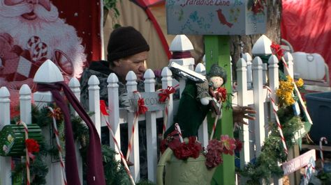 Ellwood in the documentary DESTINY'S BRIDGE putting up his Christmas decorations in Tent City, Lakewood, NJ.