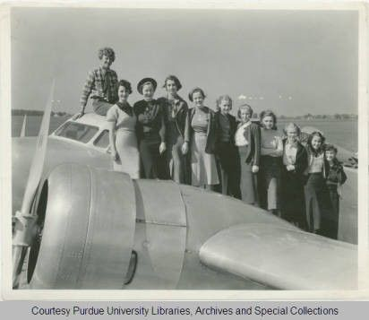Amelia Earhart On Top Of Her Lockheed Electra Plane With Purdue University Students 1926 Purdue Round The World Flights Amelia Earhart Fly Around The World