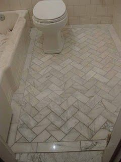I have a thing for herringbone....doing one of my sons bathrooms in this pattern but with a border...love how it looks so old fashioned, private home