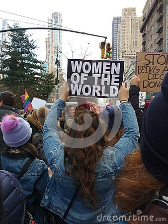 A Marcher Holds A Sign High Above Her Head That Says Women Of The World During The New York City Women S March 2018 This Photo Was T City Woman Women Photo