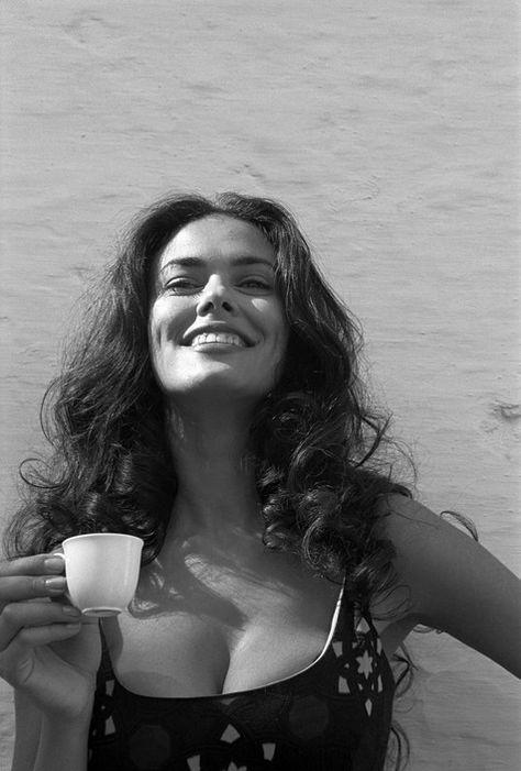 Italian actress Maria Grazia Cuccinota having a coffee on set