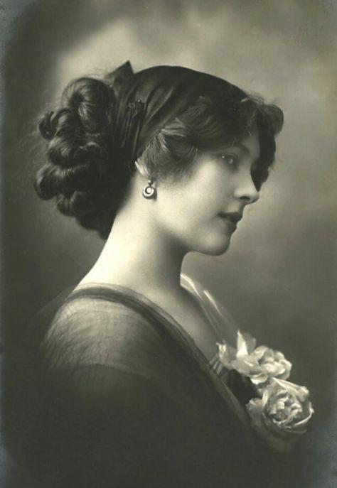 Unidentified Edwardian woman. Earrings. Pinned up hair. Flowers. Head scarf. Wrap around shoulders