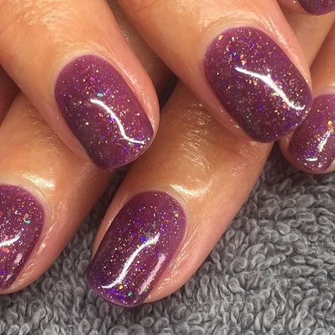 Here's new CND Shellac shade Nordic Lights by itself. It is a Semi-Sheer shade therefore the nail plate is slightly visible. Gorgeous holographic glitter sprinkled throughout. We think this will be very popular for the festive season.