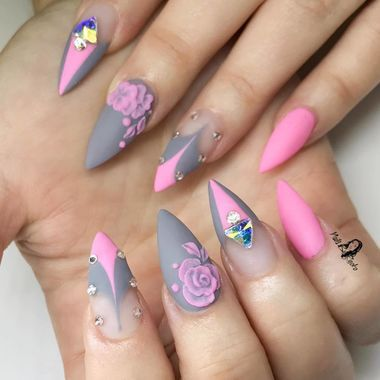 The gray and bright pink on these stiletto nails look amazing together. Add a few flowers and rhinestones and you can't really go wrong.