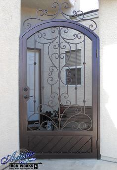 Arched Wrought Iron Courtyard Entry Gate With Scrolled Gate Topper