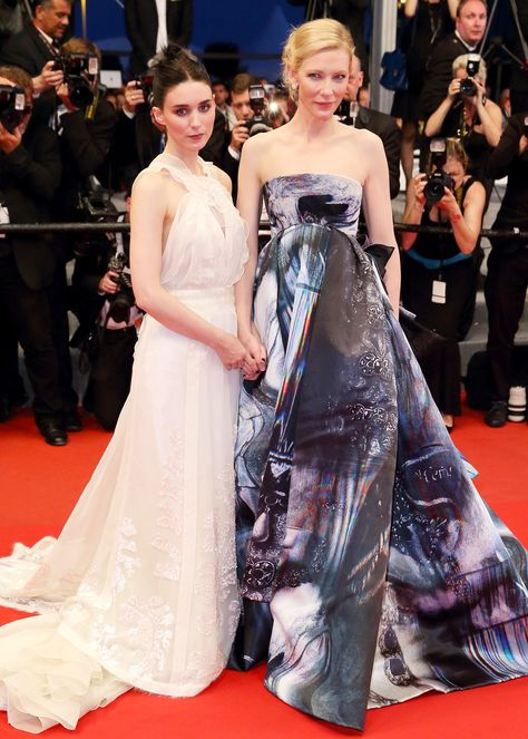 The twosome made a mark at the 68th annual Cannes Film Festival premiere of Carol in elaborate ball gowns doused in neutral hues. Mara looked to fashion archives and chose a romantic, beaded beauty from Olivier Theyskens' Rochas Fall 2005 collection. Blanchett balanced out Mara's ethereal ensemble with a moody, printed gown by Giles.