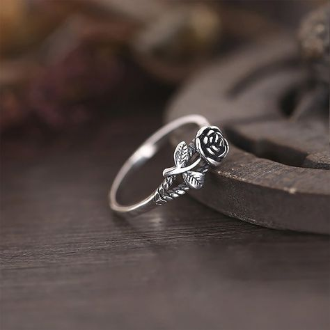 DESCRIPTION & DETAILS Edgy and unique this antiqued silver ring features a cute rose design. Ring Silver Alloy Ring Size: One Size