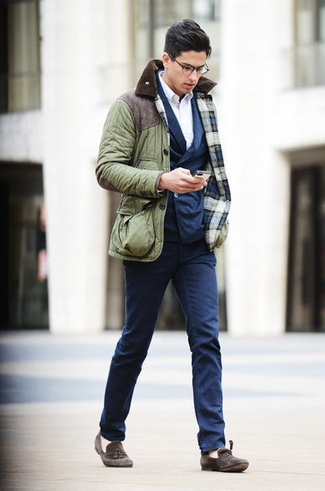 This combo of an olive green field jacket and dark blue chinos will enable you to keep your off-duty style clean and simple. Dark grey suede tassel loafers will add elegance to an otherwise simple look.  Shop this look for $518:  http://lookastic.com/men/looks/tassel-loafers-double-breasted-blazer-dress-shirt-chinos-field-jacket/1525  — Charcoal Suede Tassel Loafers  — Navy Double Breasted Blazer  — White Dress Shirt  — Navy Chinos  — Olive Field Jacket
