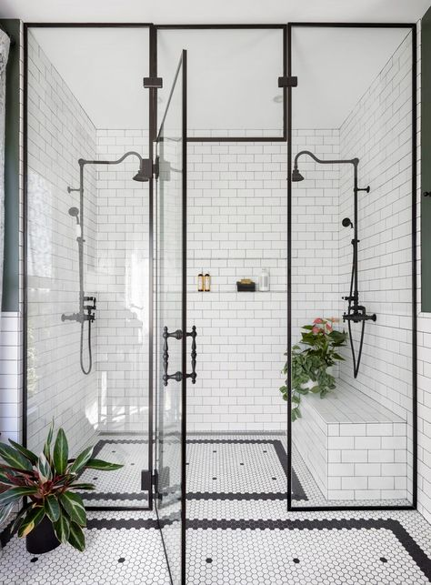 In a historic landmark home in Seattle, designer Michelle Dirkse payed homage to the home's roots with a traditionally designed black and white double shower. #walkinshower #showerideas #showerdesign #showertile #marbleshower #elledecor