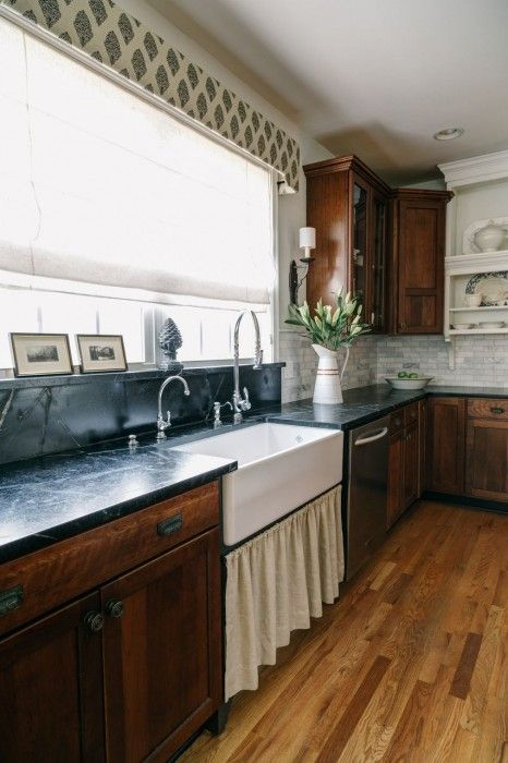 Lovely Kitchen With Cherry Cabinets Topped With Soapstone