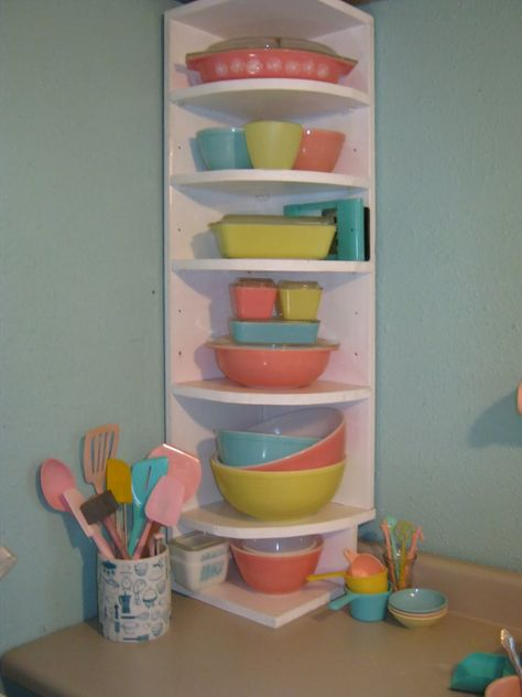 Pyrex glassware. Pink, turquoise and yellow Pyrex in a great display cabinet.