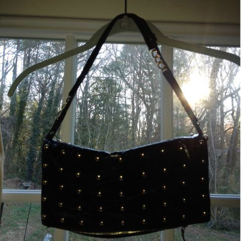 Black with gold studs you can wear this day or night. It converts into 5 different styles. www.josephcharlesbags.com to view current collection. Rarely worn, this bag has no wear or tear markings. Full retail for this bag off his website is in the $300's.