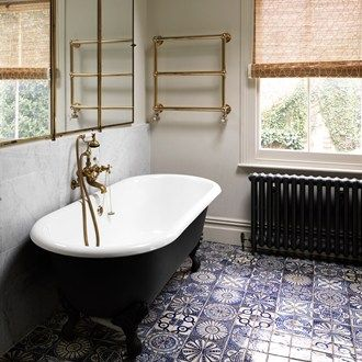 Moroccan bathroom floor tiles from Habibi Interiors are deliberately mismatched for a patchwork effect