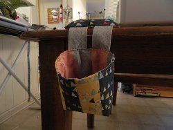 Don't get buried in a mess; just make a Super Simple Fabric Catcher to keep on the end of your quilting station.