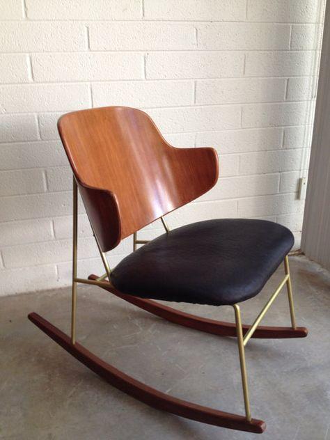 chaise à bascule en bois, cuir noir et laiton : loveit #chair #leather #wood…