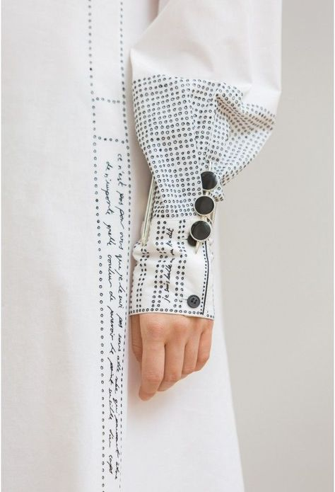 Embroidered sleeve detail with words & dots; creative fashion design detail // Lemaire- ooooh wouldn't it be cool to sew a garment then embroider all the pattern instruction on the garment itself- like an art piece