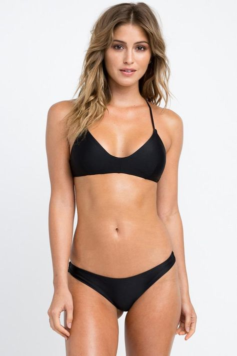 The RVCA Solid Cross Back Top is a sporty bralette-style swim bikini top with a v-cut neckline and a crossed self-tie closure at the back. This solid black bikini top has adjustable shoulder straps, bust darts, and removable bra cups. - Model is wearing a size Small. - Her measurements: Height 5'8