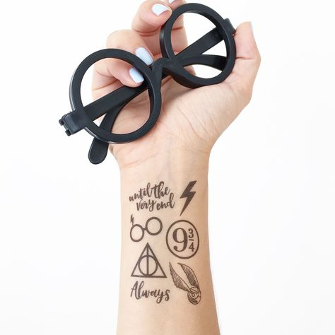 For wizards only!! You'll receive TWO sheets of 7 tattoos (7 is the most powerful number, after all). * Each order comes with two tattoo sheets and a sponge. * PROCESSING TIME: 1-2 business days BEFORE shipping (Monday-Friday) * We are not responsible for late or lost orders due to shipping.