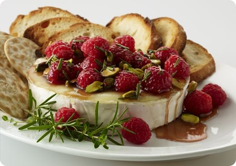 Warm Brie with Honeyed Raspberries and Pistachios.