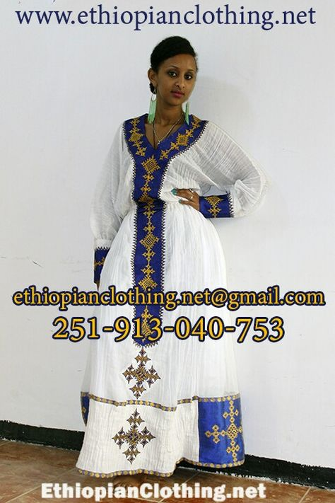 Hand embroidered blue/gold traditional dress #handmade www.ethiopianclothing.net