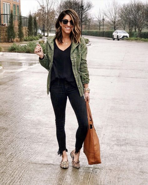 Olive jacket black shirt black pants