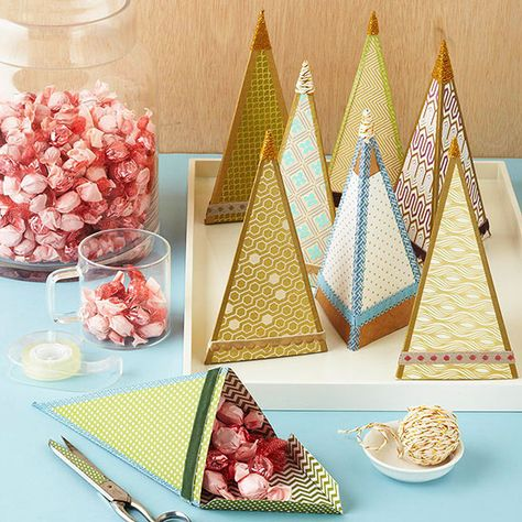 Make fancy folded treat holders as a pretty home decoration, food gift, or as party favors! Get our free download here: http://www.bhg.com/christmas/crafts/christmas-holiday-crafts/?socsrc=bhgpin110614treecandyholders&page=1
