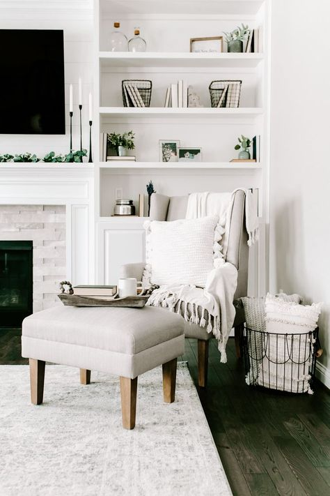 Loving this all-white living room! To get a living area like brand ambassador, Jenn Pregler, style with cozy pillows and greenery to add texture to your neutral decor!