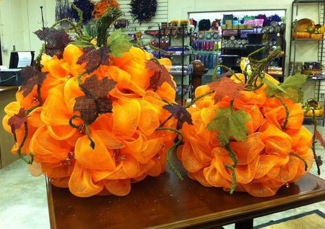 Large and Small Sitting Pumpkins made with Deco Poly Mesh.  Great for any decor.